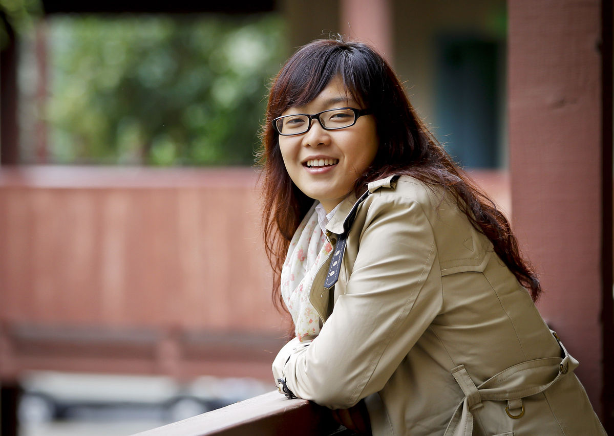Guan Wang, a freshman at the University of California, Davis, from China, stands for a portrait in Davis, California. Photo by: Tony Avelar/Bloomberg.