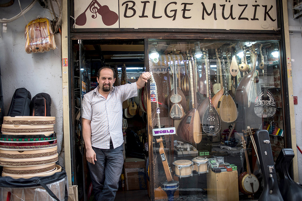 Berkant Kaya in his shop in Istanbul, where he builds and repairs traditional Turkish instruments.